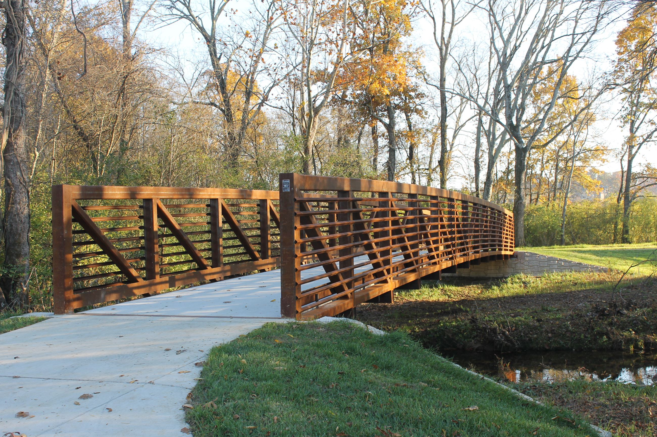 Photo of a beautiful pedestrian bridge on the McFee greenway.