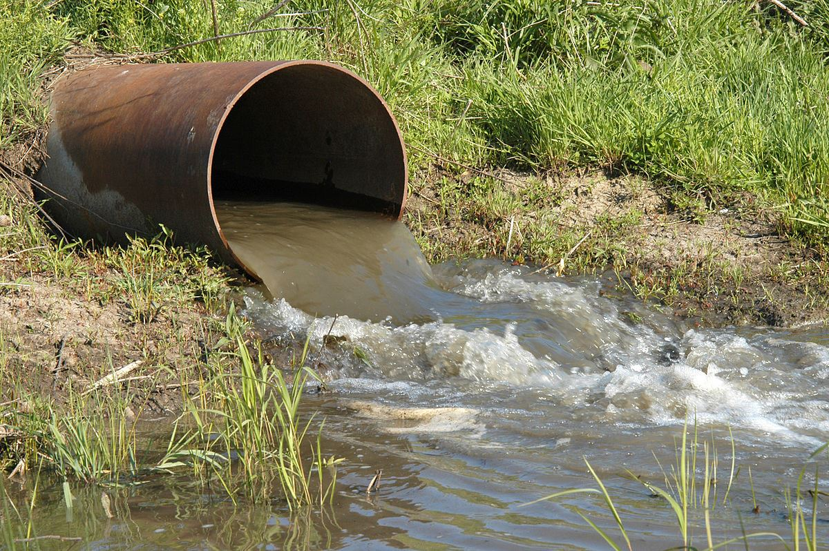 stormwater pipe discharging water into a waterway