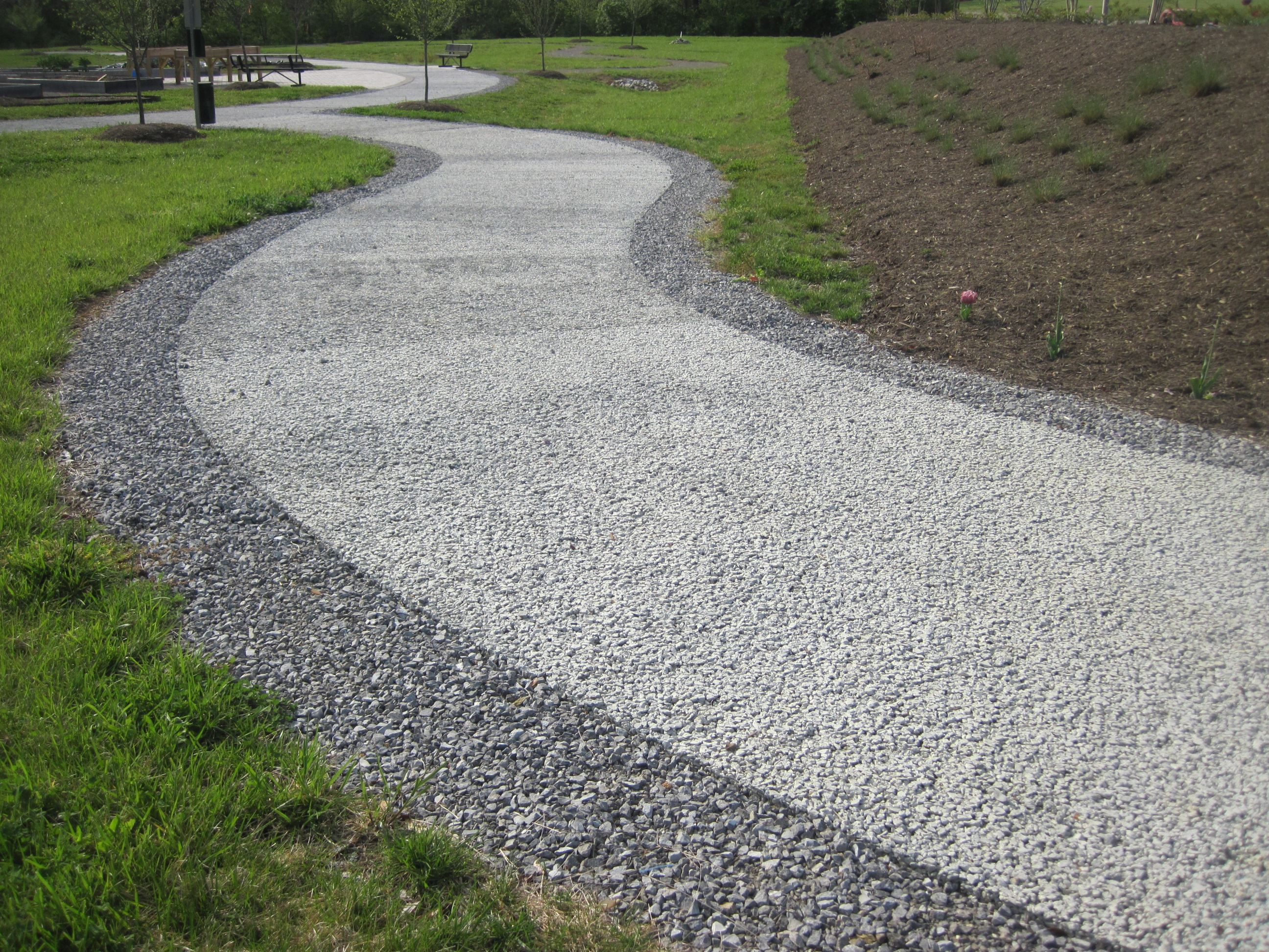 permeable concrete path winding through outdoor classroom